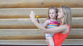 Mother and daughter taking selfies stock video footage
