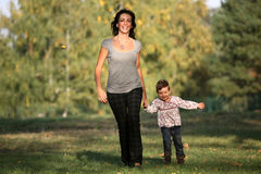 Mother and daughter taking a walk in the park stock images
