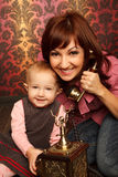 Mother and daughter talking on retro phone Stock Images