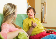 Mother with daughter talking seriously Royalty Free Stock Images