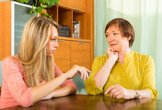 Mother with daughter talking seriously Stock Photography