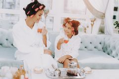 Mother and Daughter with Tea in Spa Salon on Sofa. Tea in Spa Salon. Mother and Daughter in Spa. Consept Beauty Salon. Beautiful Little Lady. Beautiful Face stock photography