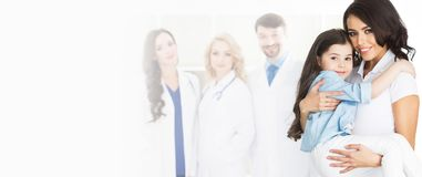 Mother, daughter and team of doctors Royalty Free Stock Images
