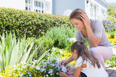 Mother and daughter tending to flowers Royalty Free Stock Image