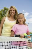 Mother and Daughter at Tennis Net portrait Stock Image