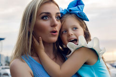 Mother and daughter three years in a blue dress big bow Royalty Free Stock Photo