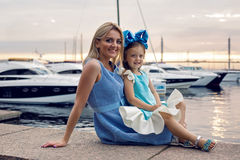 Mother and daughter three years in a blue dress big bow Royalty Free Stock Image