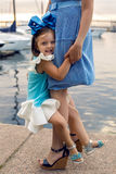 Mother and daughter three years in a blue dress big bow Stock Image