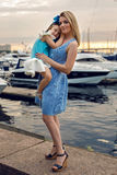 Mother and daughter three years in a blue dress big bow Stock Photos