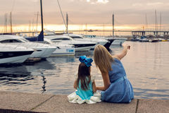 Mother and daughter three years in a blue dress   big bow Royalty Free Stock Images