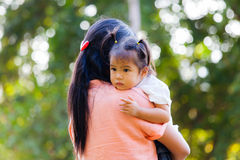 Mother and daughter are to love by hug. Mother and daughter are to love each other with a hug. Family is Thailand Royalty Free Stock Photo