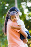 Mother and daughter are to love by hug. Mother and daughter are to love each other with a hug. Family is Thailand Royalty Free Stock Images