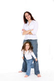 Mother and daughter together. Attractive mother and daughter in blue jeans and white shirts Stock Photography
