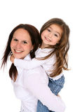 Mother and daughter together. Mother giving her toddler daughter a piggy back ride Stock Photography