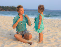 Mother and daughter together on the beach Stock Photo