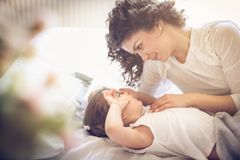 Mother waking up daughter. Happy morning. royalty free stock photo