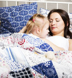 Mother with daughter together in bed smiling, happy family close up, lifestyle people concept, cool real modern family Stock Photography