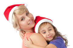 Mother and daughter together in christmas hats Stock Photos
