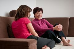 Mother and daughter together at home Stock Image