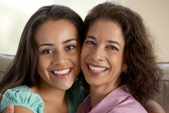 Mother And Daughter Together At Home Royalty Free Stock Photos