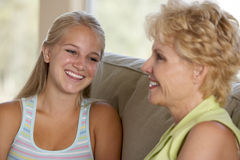 Mother And Daughter Together At Home Royalty Free Stock Image