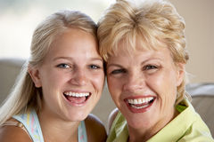 Mother And Daughter Together At Home Royalty Free Stock Photo