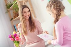 Mother and daughter together at home women`s day girl giving presents to her mom stock images