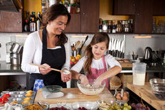 Mother and Daughter together in kitchen Royalty Free Stock Images