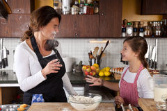 Mother and Daughter together in kitchen Royalty Free Stock Image