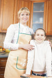 Mother and Daughter Together in the Kitchen Royalty Free Stock Photo
