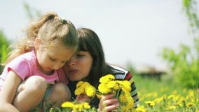 Mother and daughter together in the meadow stock footage