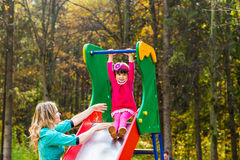Mother and daughter together on playground Royalty Free Stock Image