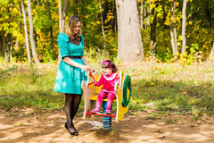 Mother and daughter together on playground Royalty Free Stock Photo