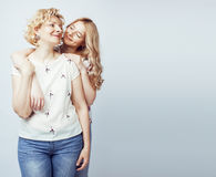 Mother with daughter together posing happy smiling isolated on white background with copyspace, lifestyle people concept Royalty Free Stock Photography