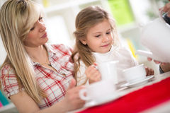 Mother and the daughter together on tea Stock Image