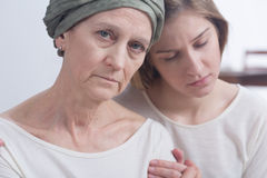Mother and daughter together in though moments Stock Photography