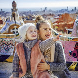 Mother and daughter tourists in Barcelona pointing on something Royalty Free Stock Images