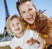 Mother and daughter tourists having fun time in Paris, France Royalty Free Stock Image
