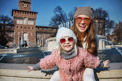 Mother and daughter tourists in Milan, Italy having fun time. Rediscovering things everybody love in Milan. Portrait of smiling modern mother and daughter Royalty Free Stock Photography