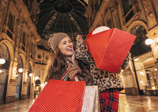 Mother and daughter tourists in Milan looking into shopping bags Royalty Free Stock Photos