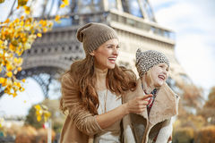 Mother and daughter tourists in Paris pointing on something Royalty Free Stock Photography