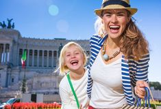 Mother and daughter tourists at Piazza Venezia in Rome, Italy. Roman Holiday. Portrait of smiling trendy mother and daughter tourists at Piazza Venezia in Rome stock photos