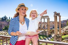 Mother and daughter tourists in Rome holding map and pointing Royalty Free Stock Photo
