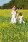 Mother and daughter in traditional clothes walking Royalty Free Stock Photo