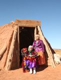 Mother and Daughter Traditional Navajo Women. Posing Outside a Traditional Hogan stock images