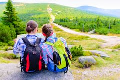 Mother and Daughter Traveler with map backpacks relaxing outdoor Royalty Free Stock Image