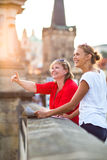 Mother and daughter traveling - two tourists studying a map Royalty Free Stock Image