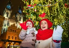 Mother and daughter travellers in Christmas Prague handwaving Stock Photos