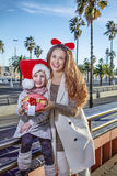 Mother and daughter travellers showing Christmas present box Stock Images