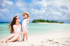 Mother and daughter at tropical beach Stock Photography